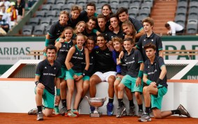Rafael Nadal of Spain celebrates victory with the ball boys and girls following the mens singles final against Stan Wawrinka of Switzerland on day fifteen of the 2017 French Open at Roland Garros on June 11, 2017 in Paris, France. (June 10, 2017 - Source: Adam Pretty/Getty Images Europe)
