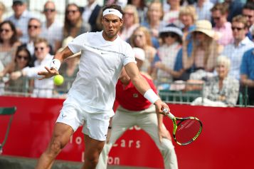 Spain's Rafael Nadal returns against Germany's Tommy Haas during the Aspall Tennis Classic at the Hurlingham Club, London, Friday June 30, 2017. (Chris Radburn/PA via AP)