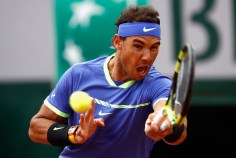 Rafael Nadal of Spain plays a backhand during mens singles quarter finals match against Pablo Carreno Busta of Spain on day eleven of the 2017 French Open at Roland Garros on June 7, 2017 in Paris, France. (June 6, 2017 - Source: Adam Pretty/Getty Images Europe)