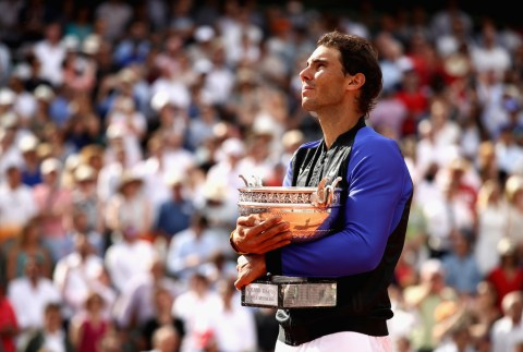 Rafael Nadal of Spain celebrates victory with the trophy following the mens singles final against Stan Wawrinka of Switzerland on day fifteen of the 2017 French Open at Roland Garros on June 11, 2017 in Paris, France. (June 10, 2017 - Source: Julian Finney/Getty Images Europe)