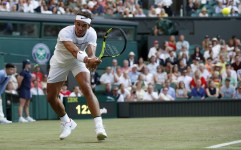 Spain's Rafael Nadal returns against US player Donald Young during their men's singles second round match on the third day of the 2017 Wimbledon Championships at The All England Lawn Tennis Club in Wimbledon, southwest London, on July 5, 2017. / AFP PHOTO / Adrian DENNIS / RESTRICTED TO EDITORIAL USE (July 4, 2017 - Source: AFP)