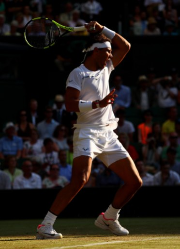 Rafael Nadal of Spain plays a forehand during the Gentlemen's Singles second round match Donald Young of The United States on day three of the Wimbledon Lawn Tennis Championships at the All England Lawn Tennis and Croquet Club on July 5, 2017 in London, England. (July 4, 2017 - Source: Clive Brunskill/Getty Images Europe)