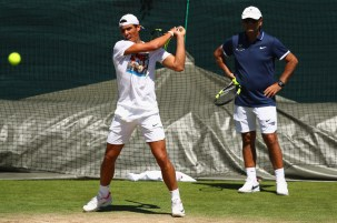 LONDON, ENGLAND - JULY 02: Rafael Nadal of Spain is watched closely by coach Toni Nadal during a practise session at Wimbledon on July 2, 2017 in London, England. (Photo by Michael Steele/Getty Images)