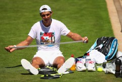 LONDON, ENGLAND - JULY 02: Rafael Nadal of Spain re grips his racket during a practice session ahead of the Wimbledon Lawn Tennis Championships at the All England Lawn Tennis and Croquet Club on July 2, 2017 in London, England. (Photo by Clive Brunskill/Getty Images)