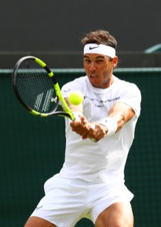 Rafael Nadal of Spain plays a backhand during the Gentlemen's Singles first round match against John Millman of Australia on day one of the Wimbledon Lawn Tennis Championships at the All England Lawn Tennis and Croquet Club on July 3, 2017 in London, England. (July 2, 2017 - Source: Michael Steele/Getty Images Europe)