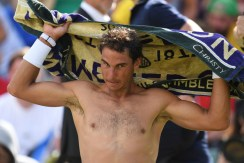 Spain's Rafael Nadal changes his shirt between games against Australia's John Millman during their men's singles first round match on the first day of the 2017 Wimbledon Championships at The All England Lawn Tennis Club in Wimbledon, southwest London, on July 3, 2017. / AFP PHOTO / Glyn KIRK / RESTRICTED TO EDITORIAL USE (July 2, 2017 - Source: AFP)