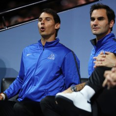 Rafael Nadal and Roger Federer of Team Europe watch the singles match between Dominic Thiem of Team Europe and John Isner of Team World on the first day of the Laver Cup on September 22, 2017 in Prague, Czech Republic. The Laver Cup consists of six European players competing against their counterparts from the rest of the World. Europe will be captained by Bjorn Borg and John McEnroe will captain the Rest of the World team. The event runs from 22-24 September. (Sept. 21, 2017 - Source: Julian Finney/Getty Images Europe)