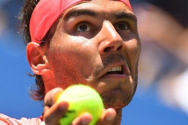 Rafael Nadal of Spain serves to Alexandr Dolgopolov of the Ukraine during their Round 4, US Open 2017, Men's Singles match at the USTA Billie Jean King National Tennis Center on September 4, 2017, in New York. / AFP PHOTO / TIMOTHY A. CLARY