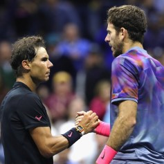 (L-R) Rafael Nadal of Spain shakes hands with Juan Martin del Potro of Argentina after their Men's Singles Semifinal match on Day Twelve of the 2017 US Open at the USTA Billie Jean King National Tennis Center on September 8, 2017 in the Flushing neighborhood of the Queens borough of New York City. Rafael Nadal defeated Juan Martin del Potro in the fourth set with a score of 4-6, 6-0, 6-3, 6-2. (Sept. 7, 2017 - Source: Elsa/Getty Images North America)