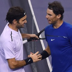 Roger Federer of Switzerland (L) is congratulated by Rafael Nadal of Spain after their men's singles final match at the Shanghai Masters tennis tournament in Shanghai on October 15, 2017. / AFP PHOTO / Chandan KHANNA (Photo credit should read CHANDAN KHANNA/AFP/Getty Images)