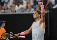 Spain's Rafael Nadal celebrates beatign Bosnia's Damir Dzumhur in their men's singles third round match on day five of the Australian Open tennis tournament in Melbourne on January 19, 2018. / AFP PHOTO / SAEED KHAN / -- IMAGE RESTRICTED TO EDITORIAL USE - STRICTLY NO COMMERCIAL USE -- (Photo credit should read SAEED KHAN/AFP/Getty Images)