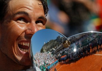Tennis - ATP - Monte Carlo Masters - Monte-Carlo Country Club, Monte Carlo, Monaco - April 22, 2018 Spain's Rafael Nadal celebrates with the trophy after winning the final against Japan's Kei Nishikori REUTERS/Eric Gaillard