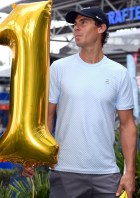 Rafael Nadal of Spain carries a number '1' to make a 2019 sign during a media call in front of the Queensland Tennis centre in Brisbane on December 31, 2018, during the Brisbane International tennis tournament. (Photo by Saeed Khan / AFP) / -- IMAGE RESTRICTED TO EDITORIAL USE - STRICTLY NO COMMERCIAL USE -- (Photo credit should read SAEED KHAN/AFP/Getty Images)