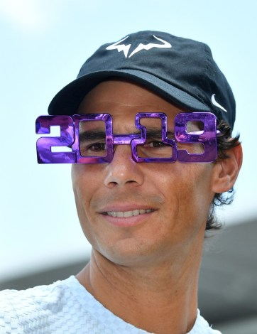 Rafael Nadal of Spain wears 2019 novelty glasses during day one of the Brisbane International tennis tournament at the Queensland Tennis Centre in Brisbane, Australia, 31 December 2018. EPA-EFE/ EDITORIAL USE ONLY AUSTRALIA AND NEW ZEALAND OUT, Image: 404799196, License: Rights-managed, Restrictions: EDITORIAL USE ONLY AUSTRALIA AND NEW ZEALAND OUT, Model Release: no, Credit line: Profimedia, TEMP EPA