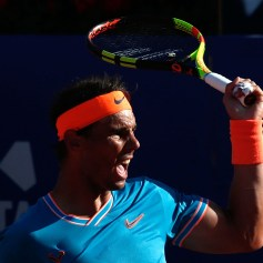 Spain's Rafael Nadal returns the ball to Austria's Dominic Thiem during the ATP Tour Barcelona Open semi-final tennis match in Barcelona on April 27, 2019. (Photo by Pau Barrena / AFP) (Photo credit should read PAU BARRENA/AFP/Getty Images)