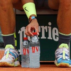 Spain's Rafael Nadal meticulously positions his water bottles during his quarterfinal match of the French Open tennis tournament against Japan's Kei Nishikori at the Roland Garros stadium in Paris, Tuesday, June 4, 2019. (AP Photo/Pavel Golovkin)