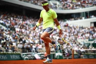 PARIS, FRANCE - JUNE 09: Rafael Nadal of Spain reacts during the mens singles final against Dominic Thiem of Austria during Day fifteen of the 2019 French Open at Roland Garros on June 09, 2019 in Paris, France. (Photo by Julian Finney/Getty Images)
