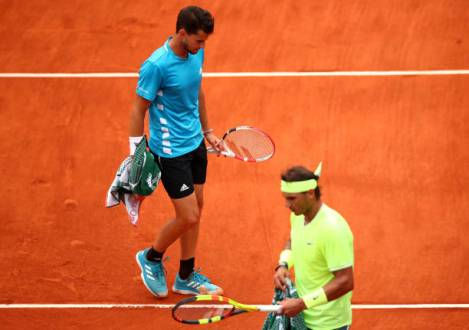PARIS, FRANCE - JUNE 09: Rafael Nadal of Spain and Dominic Thiem of Austria cross paths in their mens singles final during Day fifteen of the 2019 French Open at Roland Garros on June 09, 2019 in Paris, France. (Photo by Clive Brunskill/Getty Images)
