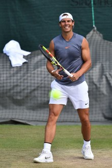 Spain's Rafael Nadal smiles as he hits a return during a practice session at The All England Tennis Club in Wimbledon, southwest London, on June 30, 2019, on the eve of the start of the 2019 Wimbledon Championships tennis tournament. (Photo by Glyn KIRK / AFP) / RESTRICTED TO EDITORIAL USE (Photo credit should read GLYN KIRK/AFP/Getty Images)