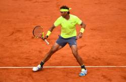 PARIS, FRANCE - JUNE 07: Rafael Nadal of Spain celebrates during his mens singles semi-final match against Roger Federer of Switzerland during Day thirteen of the 2019 French Open at Roland Garros on June 07, 2019 in Paris, France. (Photo by Clive Mason/Getty Images)