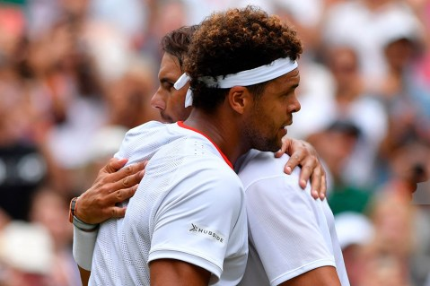 Spain's Rafael Nadal (R) embraces France's Jo-Wilfried Tsonga (L) during their men's singles third round match on the sixth day of the 2019 Wimbledon Championships at The All England Lawn Tennis Club in Wimbledon, southwest London, on July 6, 2019. (Photo by GLYN KIRK / AFP) / RESTRICTED TO EDITORIAL USE (Photo credit should read GLYN KIRK/AFP/Getty Images)