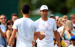 Rafael Nadal (right) and Novak Djokovic during a practice session on day nine of the Wimbledon Championships at the All England Lawn Tennis and Croquet Club, Wimbledon. (Photo by Mike Egerton/PA Images via Getty Images)