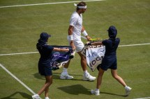Rafael Nadal (ESP) is offered Wimbledon towels during his match in the fourth round of the Gentlemen's Singles on Centre Court. The Championships 2019. Held at The All England Lawn Tennis Club, Wimbledon. Day 7 Monday 08/07/2019. Credit: AELTC/Simon Bruty