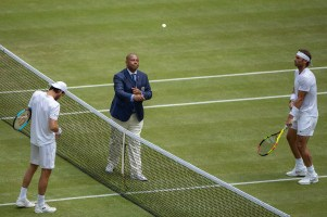 The Umpire tosses the coin ahead of the fourth round Gentlemen's Singles match between Joao Sousa (POR) and Rafael Nadal (ESP) on Centre Court. The Championships 2019. Held at The All England Lawn Tennis Club, Wimbledon. Day 7 Monday 08/07/2019. Credit: AELTC/Simon Bruty