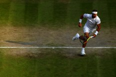 LONDON, ENGLAND - JULY 10: Rafael Nadal of Spain tracks down the ball in his Men's Singles Quarter Final match against Sam Querrey of the United States during Day Nine of The Championships - Wimbledon 2019 at All England Lawn Tennis and Croquet Club on July 10, 2019 in London, England. (Photo by Clive Brunskill/Getty Images)
