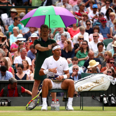 LONDON, ENGLAND - JULY 12: Rafael Nadal of Spain sits down during a change of ends in his Men's Singles semi-final match against Roger Federer of Switzerland during Day eleven of The Championships - Wimbledon 2019 at All England Lawn Tennis and Croquet Club on July 12, 2019 in London, England. (Photo by Clive Brunskill/Getty Images)