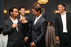 GENEVA, SWITZERLAND - SEPTEMBER 18: Rafael Nadal of Team Europe helps Fabio Fognini of Team Europe as they prepare ahead of the official welcome ceremony prior to the Laver Cup 2019 at Palexpo, on September 18, 2019 in Geneva, Switzerland. (The Laver Cup consists of six players from the rest of the World competing against their counterparts from Europe. John McEnroe will captain the Rest of the World team and Europe will be captained by Bjorn Borg) The event runs from 20-22 Sept. (Photo by Julian Finney/Getty Images for Laver Cup)