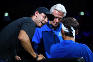 GENEVA, SWITZERLAND - SEPTEMBER 22: Rafael Nadal and Bjorn Borg, Captain of Team Europe speak to teammate Roger Federer as he sits down in his singles match against John Isner of Team World during Day Three of the Laver Cup 2019 at Palexpo on September 22, 2019 in Geneva, Switzerland. The Laver Cup will see six players from the rest of the World competing against their counterparts from Europe. Team World is captained by John McEnroe and Team Europe is captained by Bjorn Borg. The tournament runs from September 20-22. (Photo by Julian Finney/Getty Images for Laver Cup)