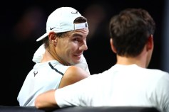 GENEVA, SWITZERLAND - SEPTEMBER 18: Rafael Nadal of Team Europe speaks with teammate Roger Federer during a practice session ahead of the Laver Cup 2019 at Palexpo, on September 18, 2019 in Geneva, Switzerland. (The Laver Cup consists of six players from the rest of the World competing against their counterparts from Europe. John McEnroe will captain the Rest of the World team and Europe will be captained by Bjorn Borg) The event runs from 20-22 Sept. (Photo by Julian Finney/Getty Images for Laver Cup)