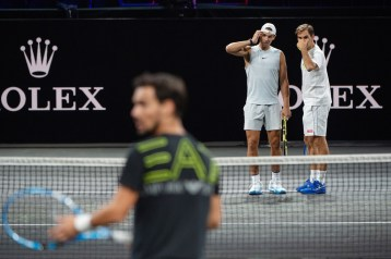 GENEVA, SWITZERLAND - SEPTEMBER 18: Roger Federer (R) and Rafael Nadal of Team Europe discuss tactics in a practice session during previews ahead of the Laver Cup 2019 at Palexpo on September 18, 2019 in Geneva, Switzerland. The Laver Cup consists of six players from the rest of the World competing against their counterparts from Europe. John McEnroe will captain the Rest of the World team and Europe will be captained by Bjorn Borg. The event runs from 20-22 Sept. (Photo by Robert Hradil/Getty Images for Laver Cup)