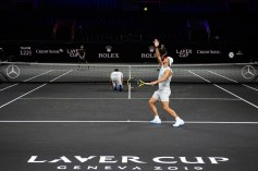 GENEVA, SWITZERLAND - SEPTEMBER 18: Roger Federer ducks as Rafael Nadal (R) of Team Europe serves during a practice session during previews ahead of the Laver Cup 2019 at Palexpo on September 18, 2019 in Geneva, Switzerland. The Laver Cup consists of six players from the rest of the World competing against their counterparts from Europe. John McEnroe will captain the Rest of the World team and Europe will be captained by Bjorn Borg. The event runs from 20-22 Sept. (Photo by Robert Hradil/Getty Images for Laver Cup)