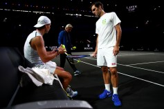 GENEVA, SWITZERLAND - SEPTEMBER 18: Roger Federer of Team Europe speaks with teammate Rafael Nadal during a practice session ahead of the Laver Cup 2019 at Palexpo, on September 18, 2019 in Geneva, Switzerland. (The Laver Cup consists of six players from the rest of the World competing against their counterparts from Europe. John McEnroe will captain the Rest of the World team and Europe will be captained by Bjorn Borg) The event runs from 20-22 Sept. (Photo by Clive Brunskill/Getty Images for Laver Cup)