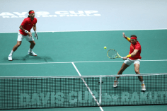 MADRID, SPAIN - NOVEMBER 23: Rafael Nadal of Spain, playing partner of Feliciano Lopez of Spain plays a backhand in their semi-final doubles match against Jamie Murray and Neal Skupski of Great Britain during Day 6 of the 2019 Davis Cup at La Caja Magica on November 23, 2019 in Madrid, Spain. (Photo by Clive Brunskill/Getty Images for LTA)