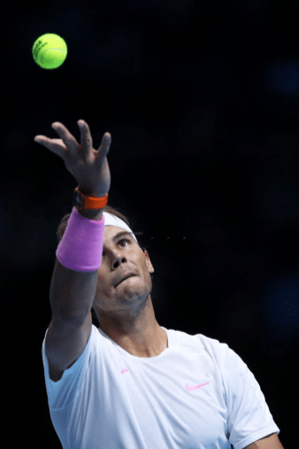 LONDON, ENGLAND - NOVEMBER 11: Rafael Nadal of Spain serves in his singles match against Alexander Zverev of Germany during Day Two of the Nitto ATP World Tour Finals at The O2 Arena on November 11, 2019 in London, England. (Photo by Naomi Baker/Getty Images)