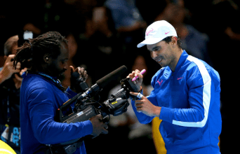 Rafael Nadal signs a camera after winning his match against Daniil Medvedev on day four of the Nitto ATP Finals at The O2 Arena, London. (Photo by Steven Paston/PA Images via Getty Images)