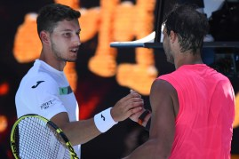 Spain's Rafael Nadal (R) shakes hands with Spain's Pablo Carreno Busta after their men's singles match on day six of the Australian Open tennis tournament in Melbourne on January 25, 2020. (Photo by William WEST / AFP) / IMAGE RESTRICTED TO EDITORIAL USE - STRICTLY NO COMMERCIAL USE (Photo by WILLIAM WEST/AFP via Getty Images)