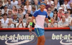 Spain's Rafael Nadal celebrates his win in the semifinal match against Andreas Seppi of Italy at the ATPtennis tournament in Hamburg, Germany, Saturday Aug. 1, 2015. (Daniel Reinhardt/dpa via AP)