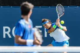 MONTREAL, ON - AUGUST 10: Rafael Nadal returns the ball in his doubles match against Tomas Berdych of the Czech Republic and Jack Sock of the USA during day one of the Rogers Cup at Uniprix Stadium on August 10, 2015 in Montreal, Quebec, Canada. (Photo by Minas Panagiotakis/Getty Images)