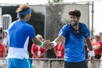 MONTREAL, ON - AUGUST 10: Fernando Verdasco of Spain encourages teammate Rafael Nadal during day one of the Rogers Cup against Tomas Berdych of the Czech Republic and Jack Sock of the USA at Uniprix Stadium on August 10, 2015 in Montreal, Quebec, Canada. (Photo by Minas Panagiotakis/Getty Images)
