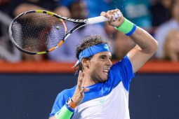 Rafael Nadal of Spain hits a return against Kei Nishikori of Japan during day five of the Rogers Cup at Uniprix Stadium on August 14, 2015 in Montreal, Quebec, Canada. Kei Nishikori defeated Rafael Nadal 6-2, 6-4. (Aug. 13, 2015 - Source: Minas Panagiotakis/Getty Images North America)