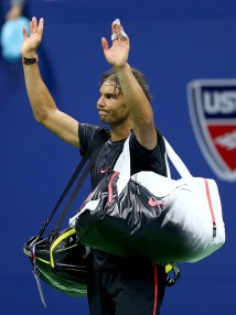 NEW YORK, NY - SEPTEMBER 04: Rafael Nadal of Spain walks off the court after his loss to Fabio Fognini of Italy on Day Five of the 2015 US Open at the USTA Billie Jean King National Tennis Center on September 4, 2015 in the Flushing neighborhood of the Queens borough of New York City. (Photo by Elsa/Getty Images)