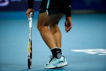 Rafael Nadal of Spain limps on the court while playing against Novak Djokovic of Serbia in their men's singles final match in the China Open tennis tournament at the National Tennis Stadium in Beijing, Sunday, Oct. 11, 2015. (AP Photo/Mark Schiefelbein)