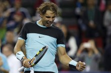 Rafael Nadal of Spain celebrates winning his men's singles tennis match against Milos Raonic of Canada at the Shanghai Masters tennis tournament in Shanghai, China, October 15, 2015. REUTERS/Aly Song