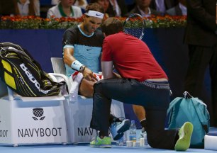Rafael Nadal of Spain receives treatment during his semi-final match against France's Richard Gasquet at the Swiss Indoors ATP men's tennis tournament in Basel, Switzerland, October 31, 2015. REUTERS/Arnd Wiegmann