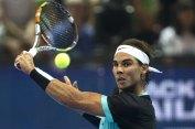 "Rafael Nadal of Spain hits a return to Novak Djokovic of Serbia during during their ""Back To Thailand - Nadal vs Djokovic"" friendly tennis match in Bangkok, Thailand, October 2, 2015. REUTERS/Athit Perawongmetha"