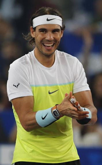 Rafael Nadal of the Indian Aces cheers his group, during the International Premier Tennis League in New Delhi, India, Saturday, Dec. 12, 2015. (AP Photo/Tsering Topgyal)